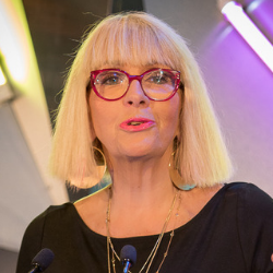 Graz van Egmond speaking microphone glasses Banksia Foundation