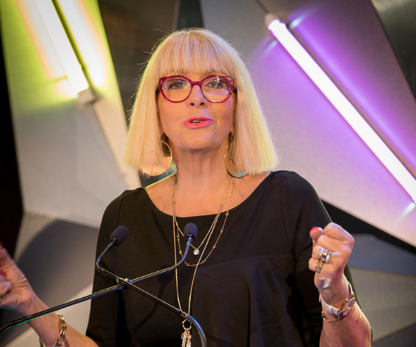 Graz van Egmond Banksia Foundation CEO on a podium giving a speech