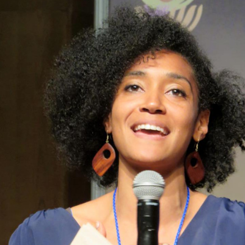 ama van dantzig moderator woman microphone speaking