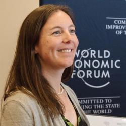 Renee van Heudsen woman brown hair background world economic forum