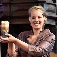 woman Dutch blonde smiling holding trophy